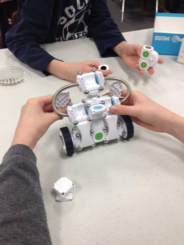 Image of students working with robotics
